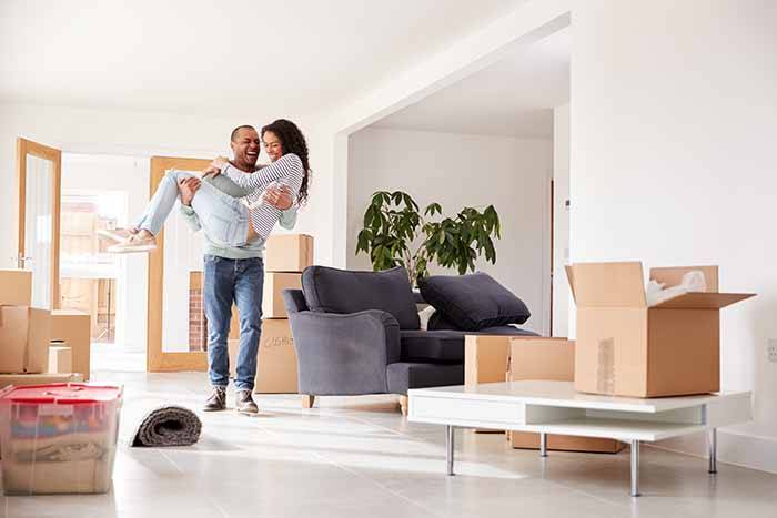 couple in new lounge on moving day